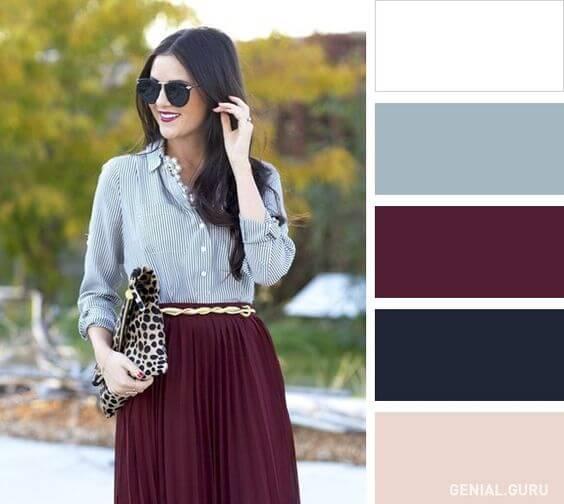 Chica con atuendo en colores blanco, bordeaux, azul grisáceo y marino.